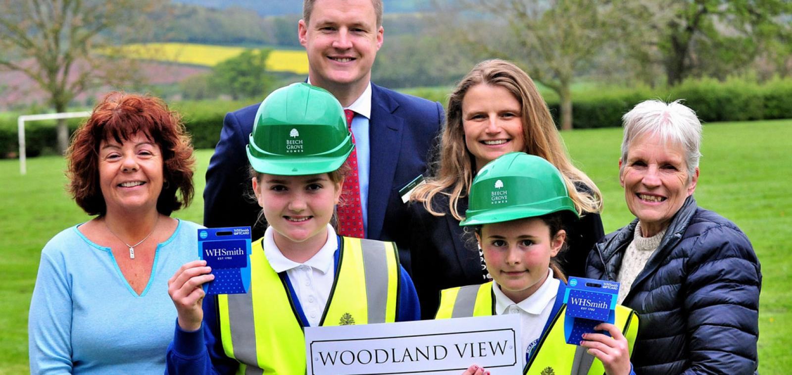 The schoolchildren who thought up the new road name with Beech Grove Homes and school staff.
