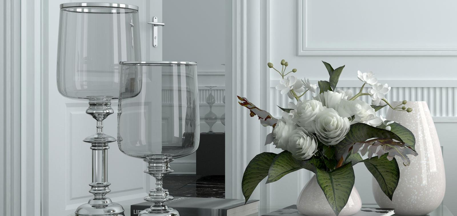 Glasses and flowers on a side table.