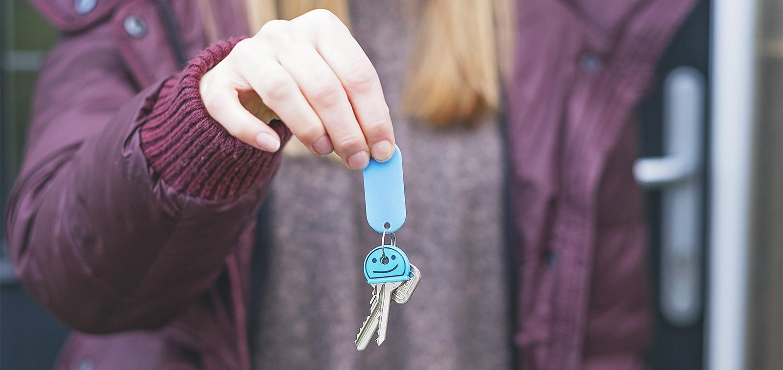 First time buyer holding the keys to their new home.